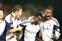 Kenny Marsally #7 of the New England Revolution is congratulated by Chris Tierney #8 and Niouky Desire #23 after scoring his second goal during an MLS match against D.C. United on April 3 2010, at RFK Stadium in Washington D.C.