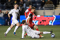Notre Dame Fighting Irish midfielder Nick Besler (8) goes for a tackle ob New Mexico Lobos midfielder Ben McKendry (6). The Notre Dame Fighting Irish defeated the New Mexico Lobos 2-0 during the semifinals of the 2013 NCAA division 1 men's soccer College Cup at PPL Park in Chester, PA, on December 13, 2013.