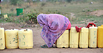 A woman waits in line at a well in Yei, Southern Sudan, provided by the United Methodist Committee on Relief (UMCOR). NOTE: In July 2011, Southern Sudan became the independent country of South Sudan