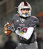 Michael Proios #10, Mepham quarterback, looks for an open receiver during the Nassau County Conference II varsity football semifinals against Carey at Hofstra University on Friday, Nov. 10, 2017.