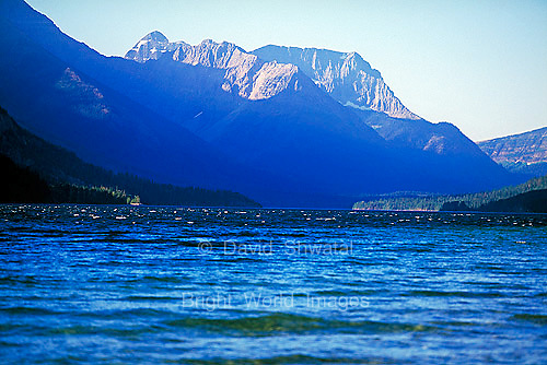 Blue Upper Wateron Lake is miles of beautiful scenic wonder with majestic mountains in Wateron Lakes National Park Alberta Canada