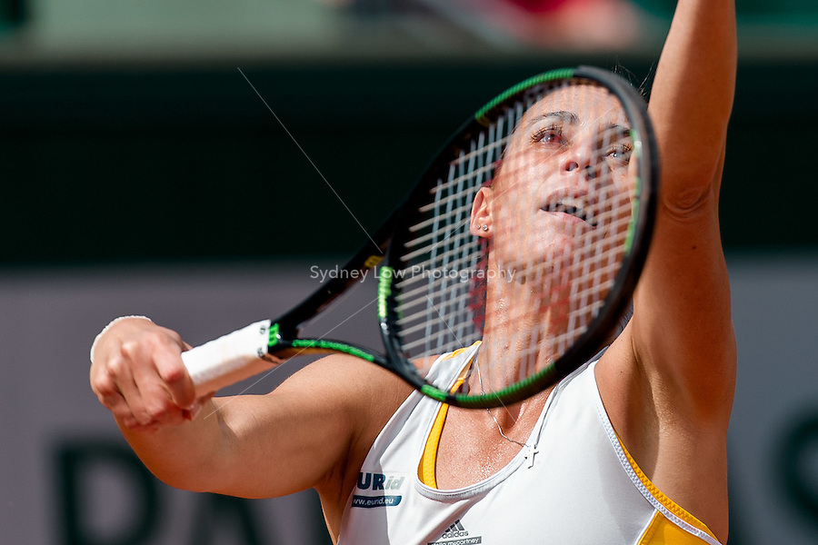 June 1, 2015: Flavia Pennetta of Italy in action in a 4th round match against Garbine Muguruza of Spain on day nine of the 2015 French Open tennis tournament at Roland Garros in Paris, France. Sydney Low/AsteriskImages