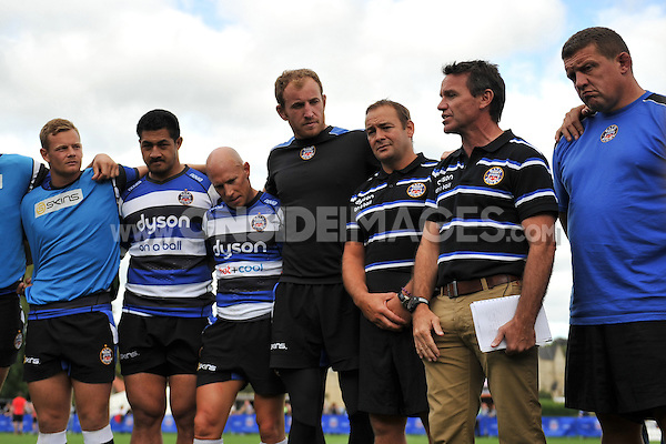 Bath Head Coach Mike Ford speaks to his players in a huddle after the match. Pre-season friendly match, between Bath Rugby and the Scarlets on August 16, 2014 at the Recreation Ground in Bath, England. Photo by: Patrick Khachfe / Onside Images