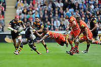Christian Wade of Wasps attempts to evade the clutches of Vereniki Goneva of Leicester Tigers
