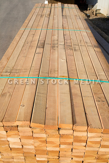 A high angle view of stacks of two by four lumber ready for use in a construction project.