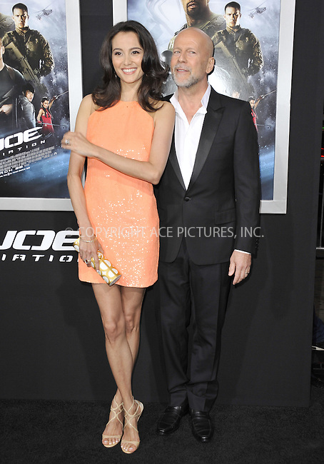 WWW.ACEPIXS.COM....March 28 2013, LA....Actor Bruce Willis (R) and his wife Emma Heming Willis arriving at the 'G.I. Joe: Retaliation' Los Angeles premiere at the TCL Chinese Theatre on March 28, 2013 in Hollywood, California.......By Line: Peter West/ACE Pictures......ACE Pictures, Inc...tel: 646 769 0430..Email: info@acepixs.com..www.acepixs.com