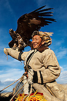 Olgi, western Mongolia<br /> Every year dozens of Kazakh hunters gather for the Golden Eagle festival amidst the craggy far western Altai Mountain range. In a long-standing tradition, the hunters dress up in their finest furs and proudly display their eagles with impressive wingspans. They play traditional games: archery, horse and camel racing and Khukh-bar, a tug of war played on horseback with a sheepskin, although the most anticipated event that these proud men come for is to show off the skills of their hunting birds. Only one bird is declared a winner. But at the end of the day each man rides out just as regally as he rode in, covering the long distance back to his village on horseback with the weight of his huge eagle impressively balanced on the crook of his arm.