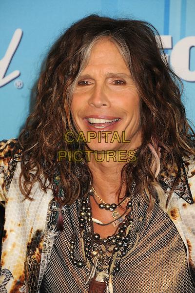 Steven Tyler of Aerosmith.American Idol Season 11 Finale - Press Room held at Nokia Theatre LA Live, Los Angeles, California, USA..May 23rd, 2012.headshot portrait brown beige necklace smiling .CAP/ADM/BP.©Byron Purvis/AdMedia/Capital Pictures.