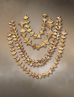 Mycenaean gold necklaces from the Mycenae chamber tombs, Greece. National Archaeological Museum Athens.<br /> <br /> From top to bottom: <br /> <br /> Top four  necklaces in the shape of papyrus flowers .<br /> <br /> Fifth necklace down in the shape of Ivy leaves from tomb 91 Cat No 3186