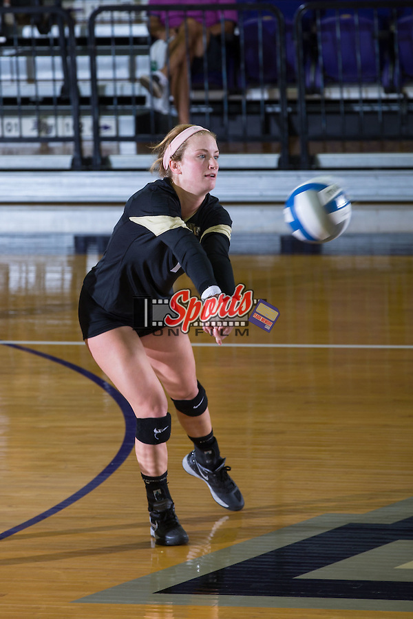 Caroline Wolf (7) of the Wake Forest Demon Deacons digs the ball against the Davidson Wildcats at the Panther Invitational at the Millis Athletic Center on September 12, 2015 in High Point, North Carolina.  The Demon Deacons defeated the Wildcats 3-0.   (Brian Westerholt/Sports On Film)