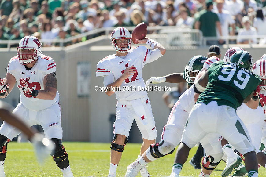 Wisconsin Badgers quarterback Alex Hornibrook (12) throws a pass during an NCAA college football game against the Michigan State Spartans Saturday, September 24, 2016, in East Lansing, Michigan.  (Photo by David Stluka)