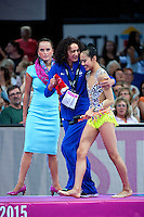 September 11, 2015 - Stuttgart, Germany - LAURA ZENG of USA is escorted by coach  ANGELINA YOVCHEVA after she performed with clubs in the All Around final to take 8th place. By placing in the top 15-gymnasts, Laura wins ticket to Rio 2016 Olympics.