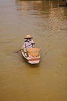 Thai woman in canal near Damnoen Saduak Floating Market, Damnoen Saduak, Thailand