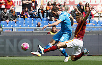 Calcio, Serie A: Roma vs Napoli. Roma, stadio Olimpico, 25 aprile 2016.<br /> Napoli&rsquo;s Gonzalo Higuain, left, is challenged by Roma&rsquo;s Lucas Digne during the Italian Serie A football match between Roma and Napoli at Rome's Olympic stadium, 25 April 2016.<br /> UPDATE IMAGES PRESS/Riccardo De Luca