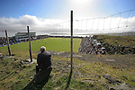 A Faroese man watching the action from the hillside outside the ground as the Faroe Islands take on Scotland in a Euro 2008 group B qualifying match at the Svangaskard stadium in Toftir. The visitors won the match by 2 goals to nil to stay in contention for a place at the European football championships which were to be held in Switzerland and Austria in the Summer of 2008. It was the first time Scotland had won in the Faroes, the previous two matches ended in draws.