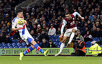 Burnley's Dwight McNeil crosses despite the attentions of  Crystal Palace's Martin Kelly<br /> <br /> Photographer Rich Linley/CameraSport<br /> <br /> The Premier League - Burnley v Crystal Palace - Saturday 30th November 2019 - Turf Moor - Burnley<br /> <br /> World Copyright © 2019 CameraSport. All rights reserved. 43 Linden Ave. Countesthorpe. Leicester. England. LE8 5PG - Tel: +44 (0) 116 277 4147 - admin@camerasport.com - www.camerasport.com