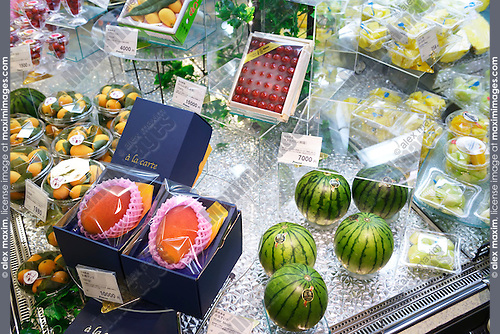 Expensive fruits, watermelon, mango on display in a Japanese supermarket. Tokyo, Japan.