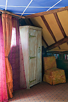 The corner of this attic bedroom is a riot of colour