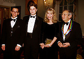 Actress Mia Farrow, second right, poses with her sons Fletcher and Lukas and former husband, Andre Previn, right, who is a 1998 Kennedy Center honoree, at the 1998 Kennedy Center Honors Dinner at the Department of State in Washington, DC. on December 5, 1998.  Each year the Kennedy Center Honors celebrate the lifetime achievements of America's greatest performing artists with a star-studded evening of song, dance, and tribute.   .Credit: George De Keerle - Pool / CNP