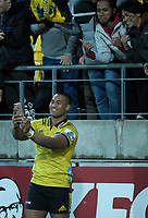Julian Savea takes a selfie with fans after the Super Rugby match between the Hurricanes and Blues at Westpac Stadium in Wellington, New Zealand on Saturday, 7 July 2018. Photo: Dave Lintott / lintottphoto.co.nz