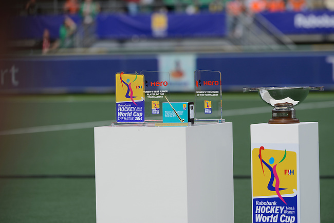 The Hague, Netherlands, June 14: (L-R) Trophies for Women´s Best Player of the Tournament, Women´s Best Junior Player of the Tournament, Women´s Best goal of the Tournament,  Women´s best Goalkeeper of the Tournament, Women´s best Topscorer of the Tournament and the World Cup Trophy before the prize giving ceremony on June 14, 2014 during the World Cup 2014 at Kyocera Stadium in The Hague, Netherlands.  (Photo by Dirk Markgraf / www.265-images.com) *** Local caption ***