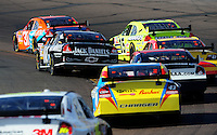 Nov. 9, 2008; Avondale, AZ, USA; NASCAR Sprint Cup Series drivers race through turn four during the Checker Auto Parts 500 at Phoenix International Raceway. Mandatory Credit: Mark J. Rebilas-