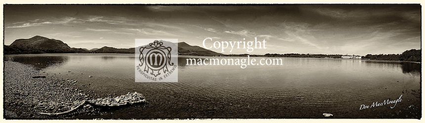 An old style sepia toned panorama view of Lough Lein Killarney with Torc Mountain on left and The Lake Hotel on right.<br />