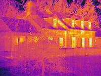 Thermogram of a house in winter.  The different colors represent different temperatures on the object. The lightest colors are the hottest temperatures, while the darker colors represent a cooler temperature.  Thermography uses special cameras that can detect light in the far-infrared range of the electromagnetic spectrum (900?14,000 nanometers or 0.9?14 µm) and creates an  image of the objects temperature..