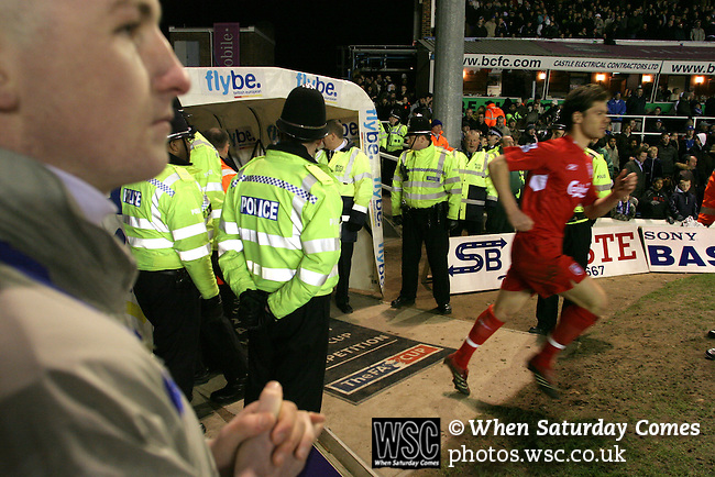 Birmingham City 0 Liverpool 7, 21/03/2006. St Andrews, FA Cup 6th Round. Birmingham City (blue) versus Liverpool,  The home side lost 0-7. Picture shows a heavy security presence protect the players as they come out for the match. Photo by Colin McPherson.