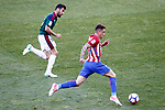 Atletico de Madrid's Jose Maria Gimenez (r) and Club Atletico Osasuna's Juan Fuentes during La Liga match. April 15,2017. (ALTERPHOTOS/Acero)