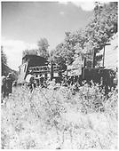 Flat car with boom and caboose derailed.  Flat car was runaway from Rico.  The boom stove in the B-end of RGS caboose #0403.<br /> RGS  Muldoon, CO  7/26/1948