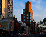 Thhe warm light of sunset reflects off the Tower of Bowery in downtown Manhattan near the Cooper Square Hotel.