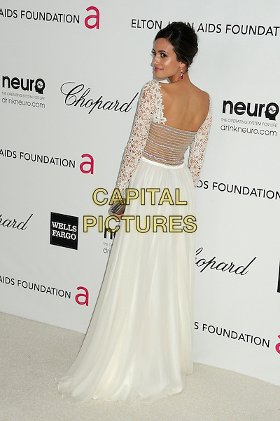 Torrey DeVitto.20th Annual Elton John Academy Awards Viewing Party held at West Hollywood Park, West Hollywood, California, USA..February 26th, 2012.full length white dress lace top skirt looking over shoulder back behind rear.CAP/ADM/BP.©Byron Purvis/AdMedia/Capital Pictures.