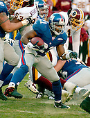 Landover, MD - December 24, 2005 -- New York Giant running back Tiki Barber (21) on a fourth quarter run in game action against the Washington Redskins at FedEx Field in Landover, MD on December 24, 2005.  The Redskins won the game 35 - 20..Credit: Ron Sachs / CNP.(RESTRICTION: NO New York or New Jersey Newspapers or newspapers within a 75 mile radius of New York City)