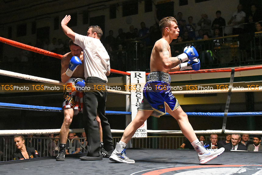 Bradley Smith (blue/grey shorts) defeats Anto Nakic during a Boxing Show at York Hall on 12th March 2016