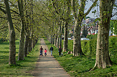 Local residents walk in Gladstone Park, Brent, London, during the Covid-19 pandemic.