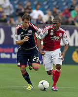 Portland Timbers forward/midfielder Darlington Nagbe (6) on the attack with New England Revolution forward Blake Brettschneider (23) in pursuit. In a Major League Soccer (MLS) match, the New England Revolution defeated Portland Timbers, 1-0, at Gillette Stadium on March 24, 2012