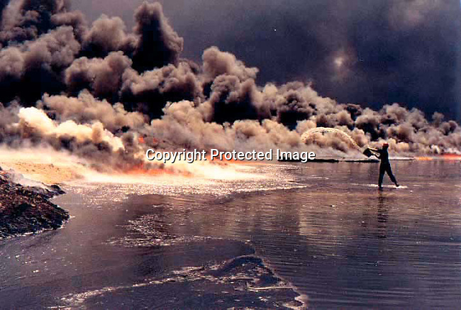 An unidentified firefighter from USA putting out fires at the destroyed wells at the Burhan oilfields in Kuwait on August 13, 1991 in the aftermath of the Gulf War. President Saddam Hussein of Irak ordered the wells to be destroyed while his troops withdrew from Kuwait. .(Photo Per-Anders Pettersson)