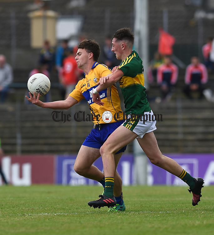 Ciaran O Donoghue of Clare in action against Sean O'Leary of Kerry during their Minor Munster final at Killarney.  Photograph by John Kelly.