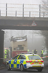 Pix: Shaun Flannery/shaunflanneryphotography.com...COPYRIGHT PICTURE>>SHAUN FLANNERY>01302-570814>>07778315553>>..15th March 2011...........Scene of a school bus crash at Works Road, Hollingwood, Chesterfield..The TM Travel double decker bus carrying pupils from St Mary's Catholic High School in Chesterfield attempted to travel beneath a low bridge, it's roof was ripped off.