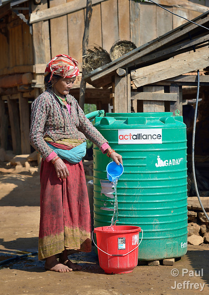 Pamfa Maya Pulami fetches water from a cistern in Salang, a village in the Dhading District of Nepal where Dan Church Aid, a member of the ACT Alliance, has provided a variety of support to local villagers in the wake of a devastating 2015 earthquake. The village's water system was destroyed by the quake, forcing women to walk two hours or more to a nearby river to fetch water. Working with a local organization, the Forum for Awareness and Youth Activity, the ACT Alliance rebuilt the village's water system.