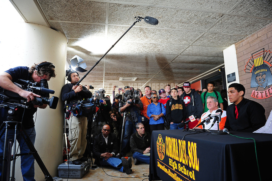 Feb. 1, 2012; Tempe AZ, USA; Corona del Sol Aztecs offensive lineman Andrus Peat (right) speaks at a press conference at Corona del Sol High School to announce his decision to play college football for the Stanford Cardinal. Mandatory Credit: Mark J. Rebilas-