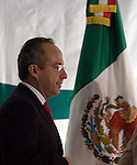 Felipe Calderon walks past a Mexican flag prior to receive his acreditacion as President-elect by Congress President Jorge Zermeno at his campaign office, September 7, 2006.  © Photo by Javier Rodriguez