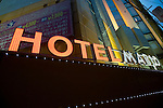 A neon sign stands on the exterior of Hotel Mario love hotel on the outskirts of Tokyo, Japan on Monday 20 April  2009.  .Photographer: Robert Gilhooly