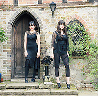 Pearl and Daisy Lowe wearing Lowe's lace dresses in front of their family house in Hampshire