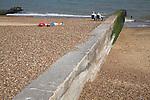 Coastal defences, Felixstowe, Suffolk, England. Concrete groyne showing different beach levels due to longshore drift.