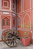 Canon in front of decorated wall, Amber Fort, Jaipur, India