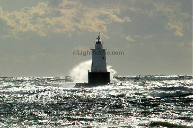 Storm surf breaks over Sakonnet Light at the entrance to the Sakonnet River, Little Compton RI.
