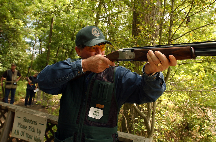 Sen. Mike Crapo, R-Idaho, fires at a clay pigeon during the 2005 Congressional Shootout, at Prince George's County Sheet Center, Monday