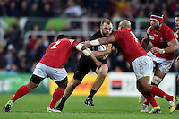 Owen Franks of New Zealand takes on the Tonga defence. Rugby World Cup Pool C match between New Zealand and Tonga on October 9, 2015 at St James' Park in Newcastle, England. Photo by: Patrick Khachfe / Onside Images